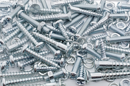 woodscrew: Macro Shot of A Big Collection Of Iron Screws, Nuts and lockwashers Stock Photo