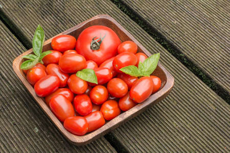 floorboards: Tomatoes In A Wooden Bowl On Floor Boards