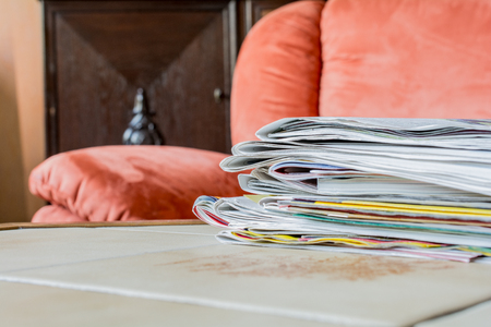 periodicals: Stack Of Newspapers On A Table Tile Stock Photo