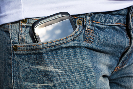 Woman With Smartphone In Her Pants Pocket photo