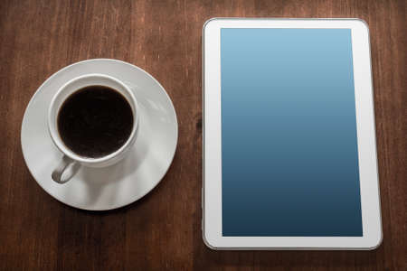 telework: Business Work With Tablet A Cup Of Coffee Stock Photo