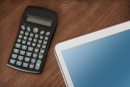 telework: Business Work With Tablet Calculator