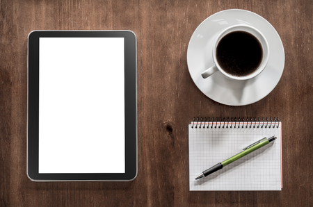 assignment: Notepad With Pencil, A Tablet And Coffee On A Living-Room Table