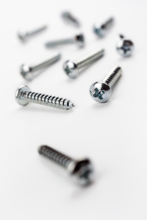 medium length: Medium Length Iron Screws In A White Box - Crooked Angle