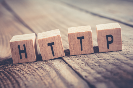 Closeup Of The Word HTTP Formed By Wooden Blocks On A Wooden Floor Stockfoto