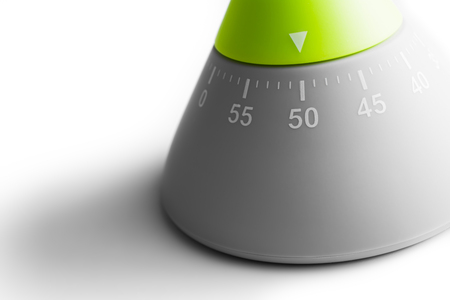 50 Minutes - Macro Of An Analog Kitchen Egg Timer Stock Photo