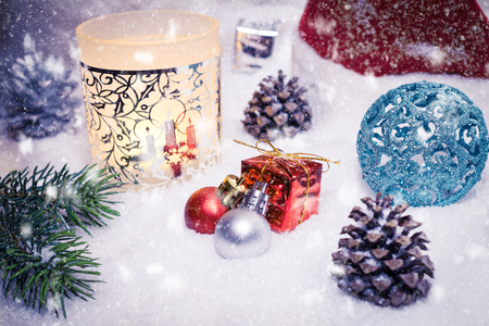 Yellow Lantern With Christmas Decoration And Falling Snow