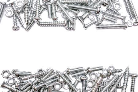 A Collection Of Iron Screws, Woodscrews and Bolts With A Free Line For Text In The Middle 스톡 콘텐츠