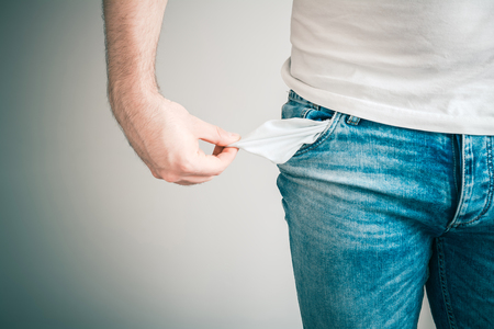 Man Showing His Empty Pockets, Poor Man Concept Stock Photo