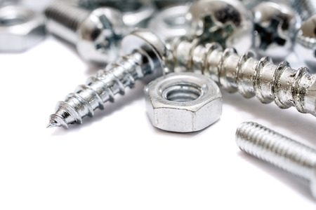 A Macro Of A Small Collection Of Iron Screws, Woodscrews And Bolts With Free Space