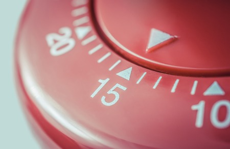 15 Minutes - A Macro Of A Flat Red Kitchen Egg Timer Stock Photo