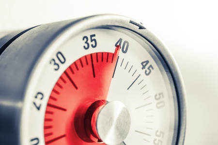 40 Minutes - Analog Kitchen Timer With Red Mark Placed On A Frid Stock Photo