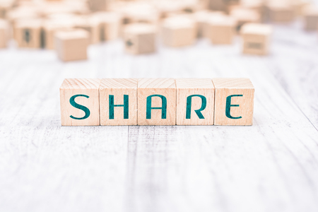 The Word Share Formed By Wooden Blocks On A White Table, Social Media Concept Imagens