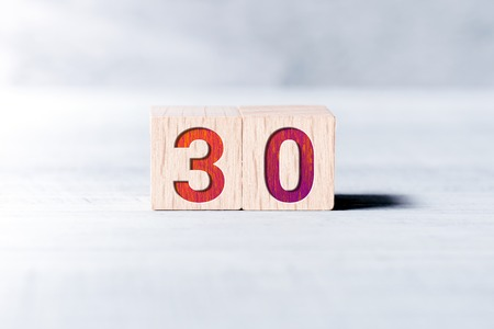 Number 30 Formed By Wooden Blocks On A White Table