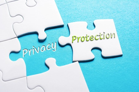 The Words Privacy And Protection In Missing Piece Jigsaw Puzzle 스톡 콘텐츠
