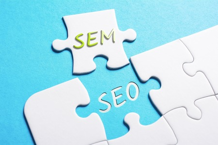 The Words SEO And SEM In Missing Piece Jigsaw Puzzle