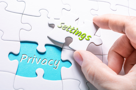 The Words Privacy And Settings In Missing Piece Jigsaw Puzzle Stockfoto - 110229159