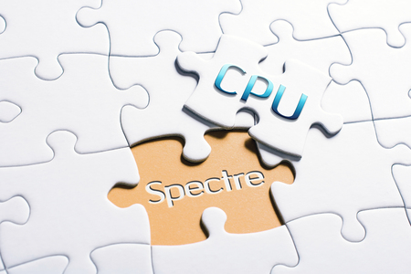 The Words CPU And Spectre In Missing Piece Jigsaw Puzzle 스톡 콘텐츠