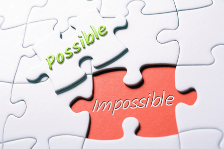 The Words Possible And Impossible In Missing Piece Jigsaw Puzzle 스톡 콘텐츠
