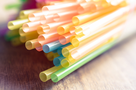 Macro Of A Bunch Colored Drinking Straws On A Wooden Table