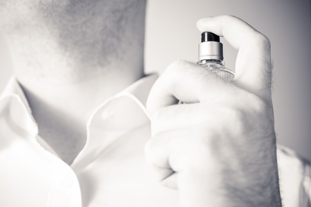 Businessman Using A Parfume Bottle On His Neck, Monochrome Colors