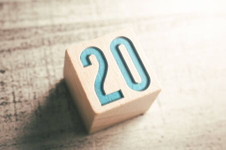 The Number 20 On A Wooden Block On A Table