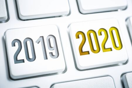 The Year 2019 And 2020 On Two White Keyboard Buttons Stock fotó