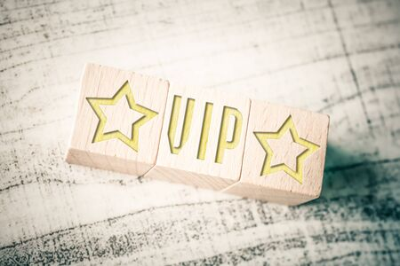 The Word VIP With Two Stars On Wooden Blocks On Table Stock fotó