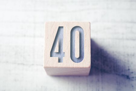 The Number 40 On A Wooden Block On A Table