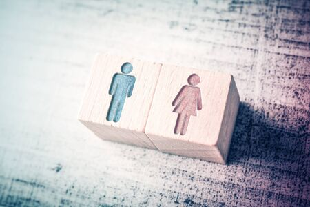 Gender Icons For Male And Female On Wooden Blocks On Table