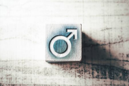 Gender Icon For Male On Blue Wooden Block On A Table