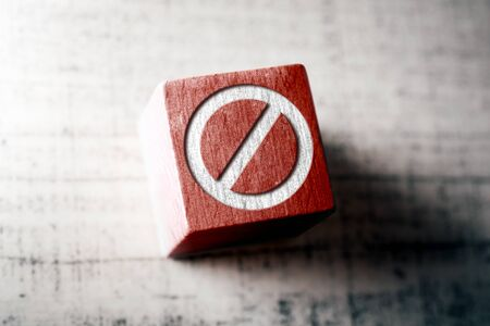 Prohibition Sign On Red Wooden Block On A Table Stock Photo