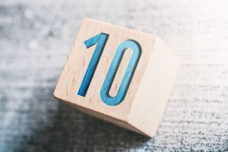 The Number 10 On A Wooden Block On A Table