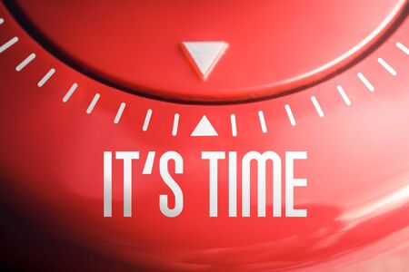 Macro of the Words IT'S TIME On Flat Red Kitchen Egg Timer Stock Photo