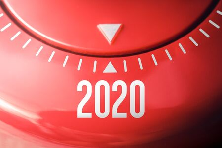 The Year 2020 On A Flat Red Kitchen Egg Timer