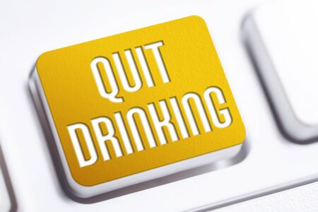 Quit Drinking Concept With An Orange Quit Drinking Button On A White Keyboard
