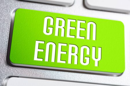 Green Power Concept With A Green Energy Button On A White Keyboard