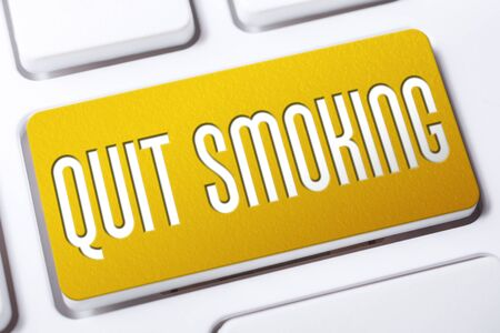 Quit Smoking Concept With A Yellow Quit Smoking Button On A White Keyboard