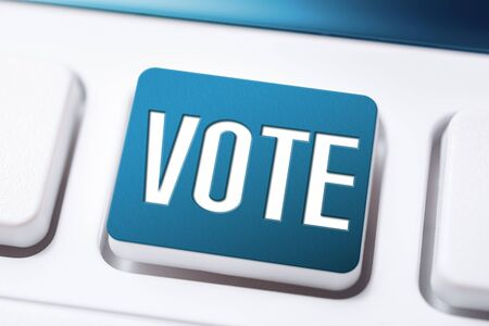 Blue Vote Button On A White Keyboard, Time For A Change Concept Stock Photo