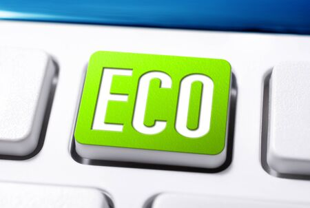Green Eco Button On A White Keyboard, Clean Environment and Energy Concept Stock Photo
