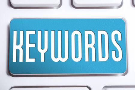 Blue Keywords Button On White Keyboard Stock Photo