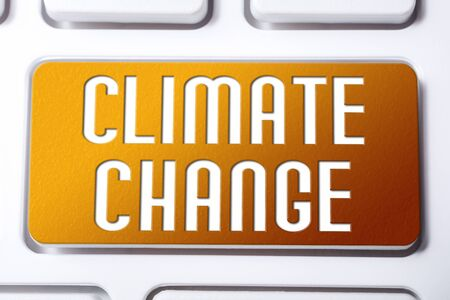 Orange Climate Change Button On A White Keyboard, Fragile Future Concept