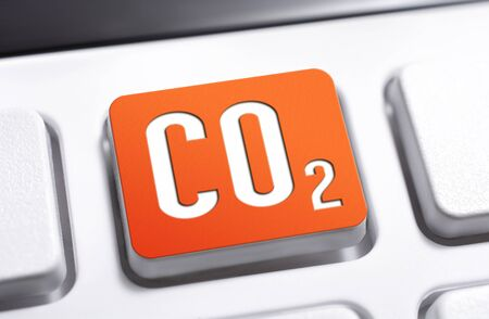 CO2 Chemical Formula For Carbon Dioxide On An Orange Keyboard Button, Warning For Global Warming Concept Stock Photo