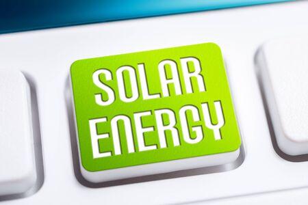 Green Solar Energy Keyboard Button, Clean Energy Concept Stock Photo