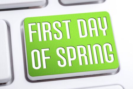 Green First Day Of Spring Button On White Keyboard Stock Photo