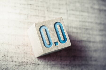 Number 0.0 On A Wooden Block On A Table Stock Photo