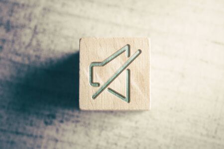 Volume Mute Icon On A Wooden Block On A Table Stock Photo