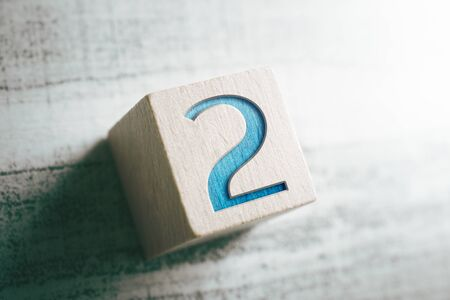 Number 2 On Wooden Block On A Table Stock Photo