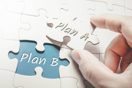 Plan A and Plan B In Missing Piece Jigsaw Puzzle, Two Fingers Holding Plan A Piece