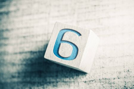 Number 6 On Wooden Block On A Table Stock Photo